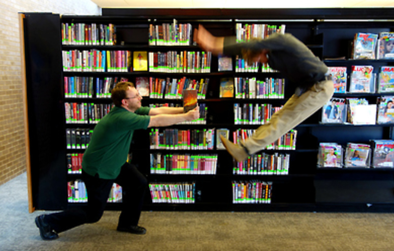 Extra_large_fighting_in_library