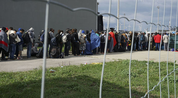 Homepage 1200px a line of syrian refugees crossing the border of hungary and austria on their way to germany. hungary  central europe  6 september 2015