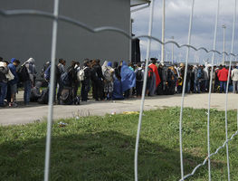 Small_1200px-a_line_of_syrian_refugees_crossing_the_border_of_hungary_and_austria_on_their_way_to_germany._hungary__central_europe__6_september_2015