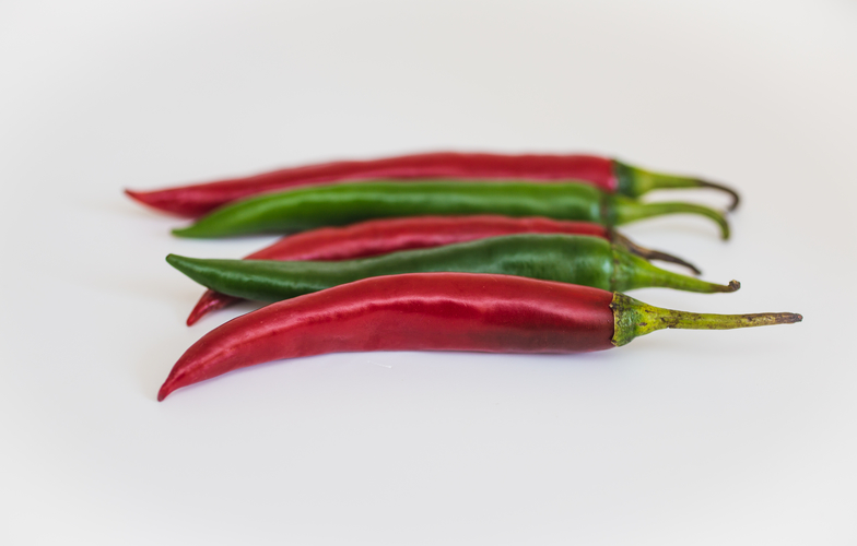 Extra_large_canva_-_two_green_and_three_red_chili_peppers