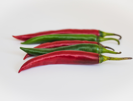 Small_canva_-_two_green_and_three_red_chili_peppers
