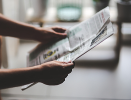 Small_canva_-_person_reading_a_newspaper
