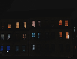 Small_canva_-_multi-storey_building_with_open_windows_during_nighttime