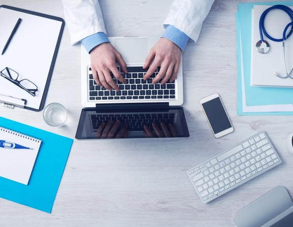 Large_business-doctor-with-a-laptop-and-equipment-205-small