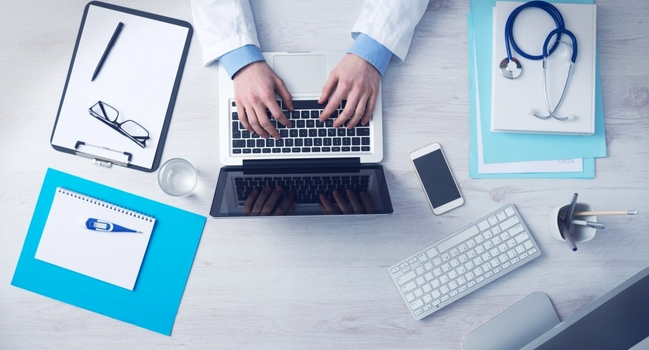 Wide_business-doctor-with-a-laptop-and-equipment-205-small