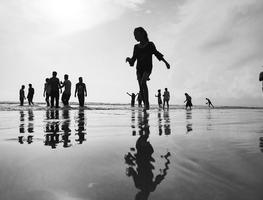 Small_canva_-_woman_walking_on_the_seashore